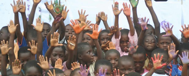 Students waving at art workshop in Ghana